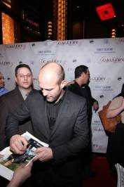 Jason Statham signs autographs on the red carpet at Gallery Nightclub.