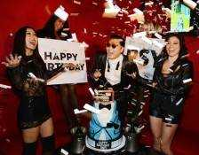 Psy with his birthday cake. Photos: Denise Truscello/WireImage