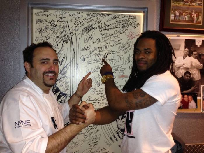 Chef Barry Dakake and Richard Sherman with the shakedown door.