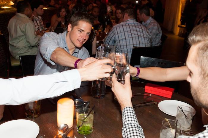 Jason Kennedy toast with Whole World Water at Tao. Photos: Brenton Ho/Powers Imagery