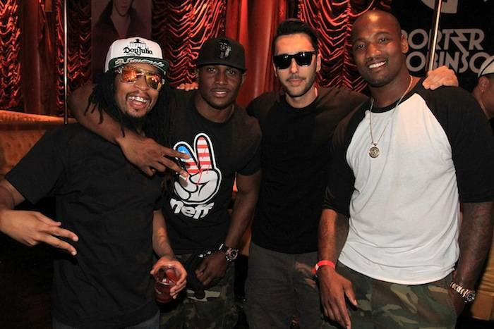 Lil Jon, Reggie Bush, Cedric Gervais and Shaun Phillips behind Encore Beach Club's DJ booth inside Surrender Nightclub. Photos: Amanda Nowak