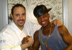 "Ne-Yo and executive chef Barry Dakake pose in front of the celebrity ""Shake Down Door"" at N9NE Steakhouse."