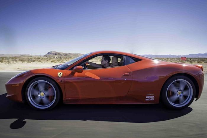 Travis Cloer driving a Ferrari 458 through Red Rock Canyon; Photo Credit...