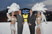 Silver Sevens vice president and general manager David Nolan and Affinity Gaming's senior vice president of Nevada operations Loren Gill pose with classic Las Vegas showgirls after the lighting of the property's new marquee. Photos: Las Vegas Photo & Video