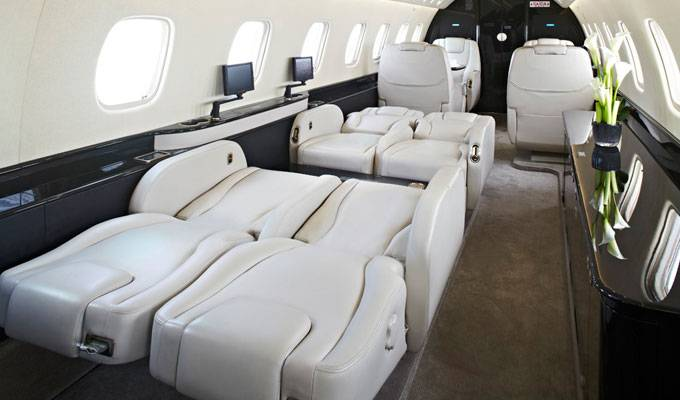 Haute jet of the week embraer legacy 650 haute living for Large cabin business jets