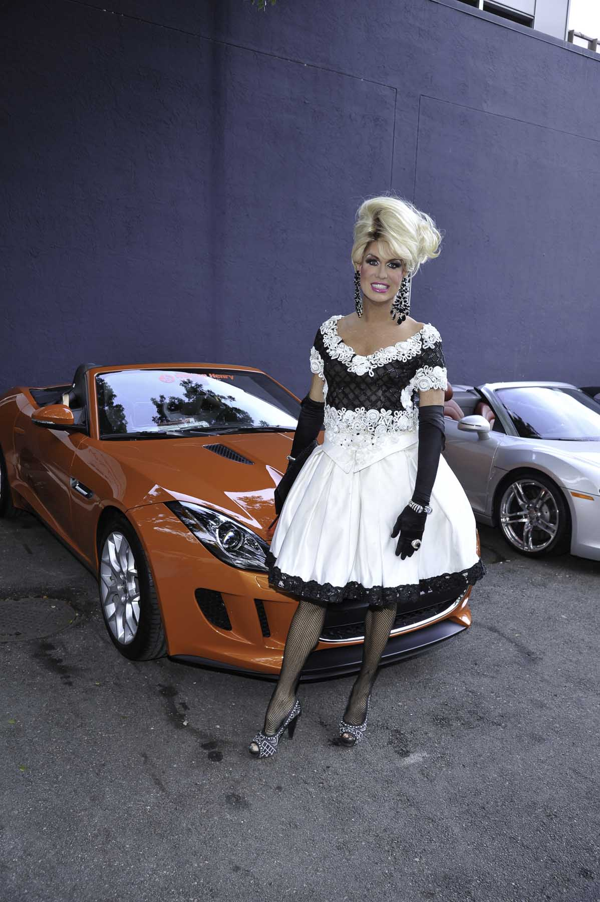 Elaine Lancaster with a 2014 Jaguar F-Type from Warren Henry Jaguar, a division of Warren Henry Auto Group