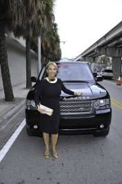 Lea Black of The Real Housewives of Miami – Season 3 with a Range Rover from Land Rover North & South Dade, divisions of Warren Henry Auto Group