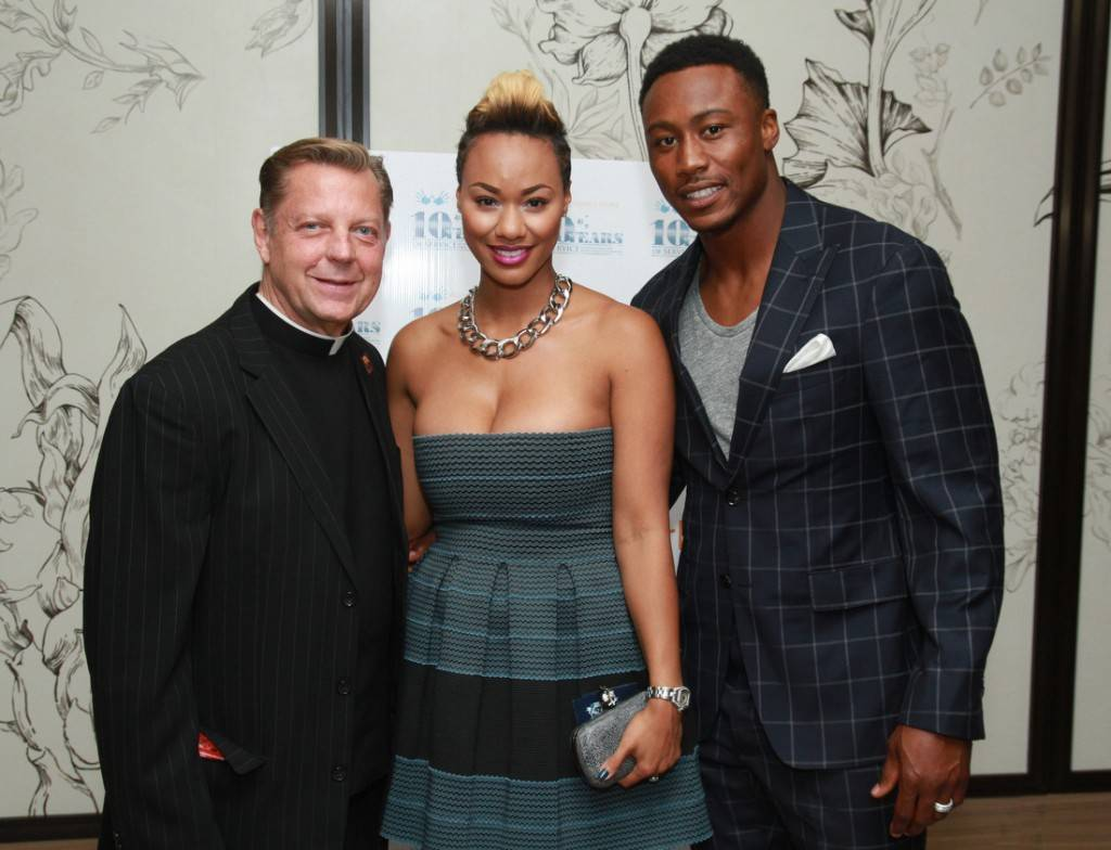 Rev. Pfleger, Michi and Brandon Marshall