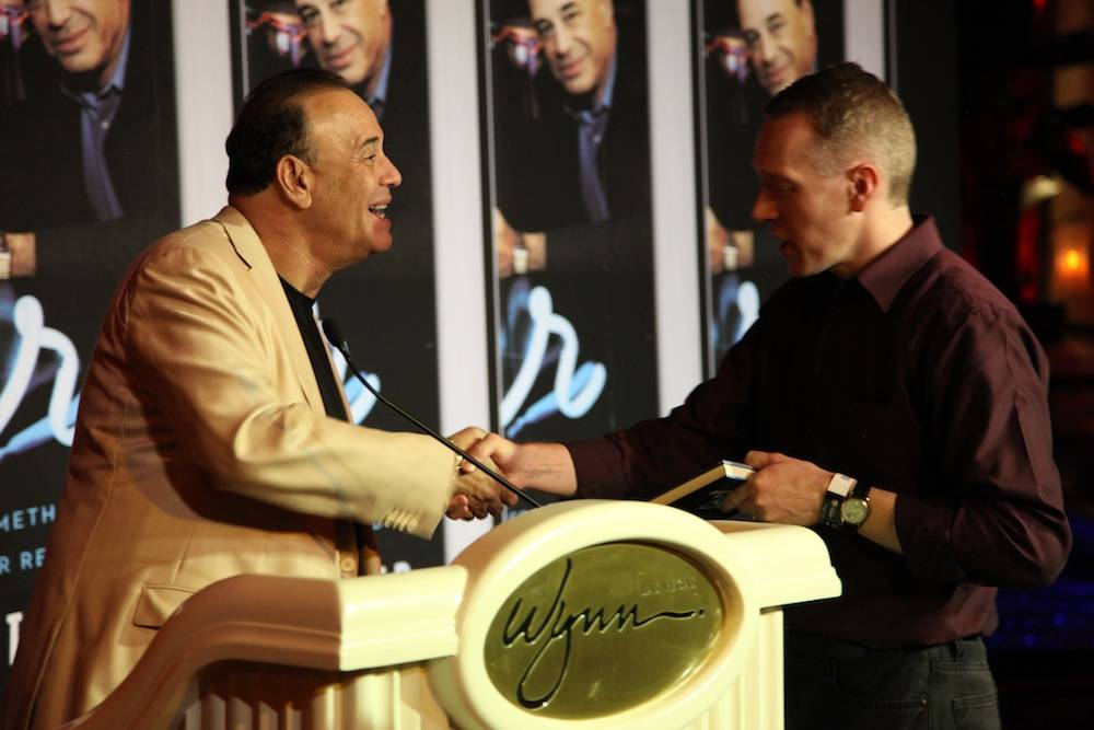 Jon Taffer offering words of wisdom to a fan during the Oct. 11 book signing