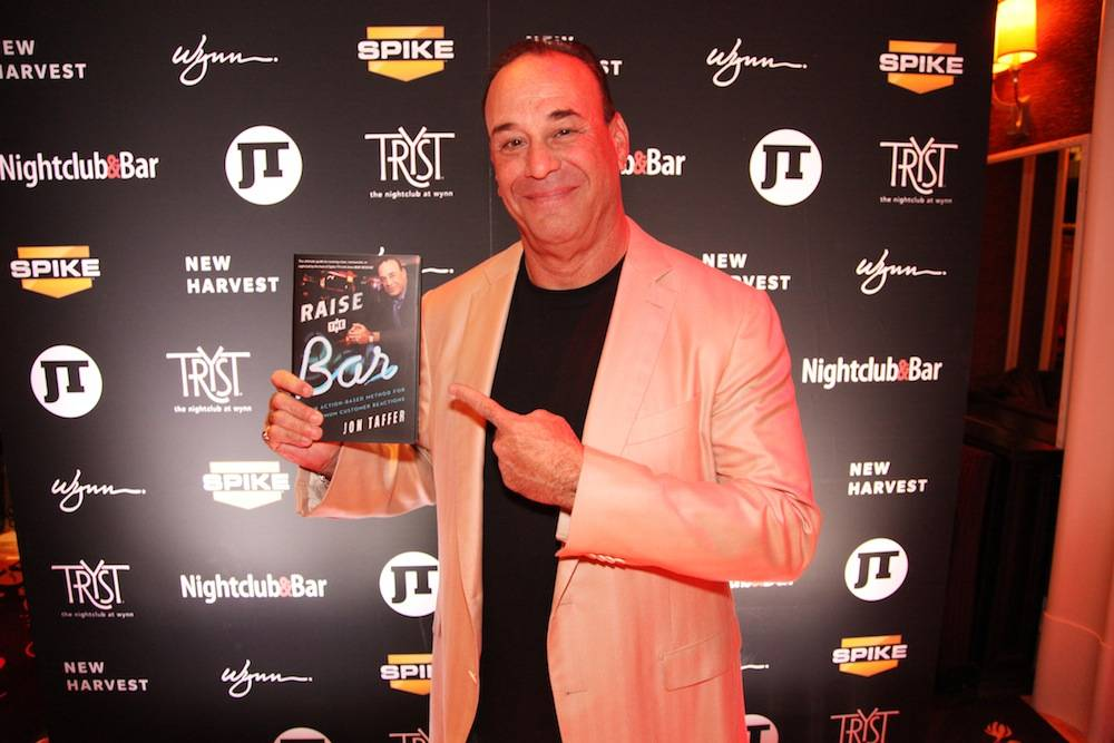 "Jon Taffer with his newest book ""Raise the Bar - An Action-Based Method for Maximum Customer Reactions"""