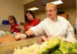Lidia Bastianich prepares meals with Bank of America volunteers at Three Square Food Bank. A group of nearly 30 volunteers prepared more than 6,000 meals together on site.