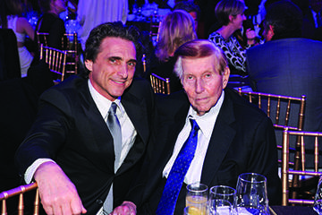 Sumner Redstone (cut man on left)