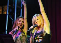 Audrina Patridge and Lita Ford Wave to Crowd After Performing During RRFC at Mandalay Bay 3.2.14