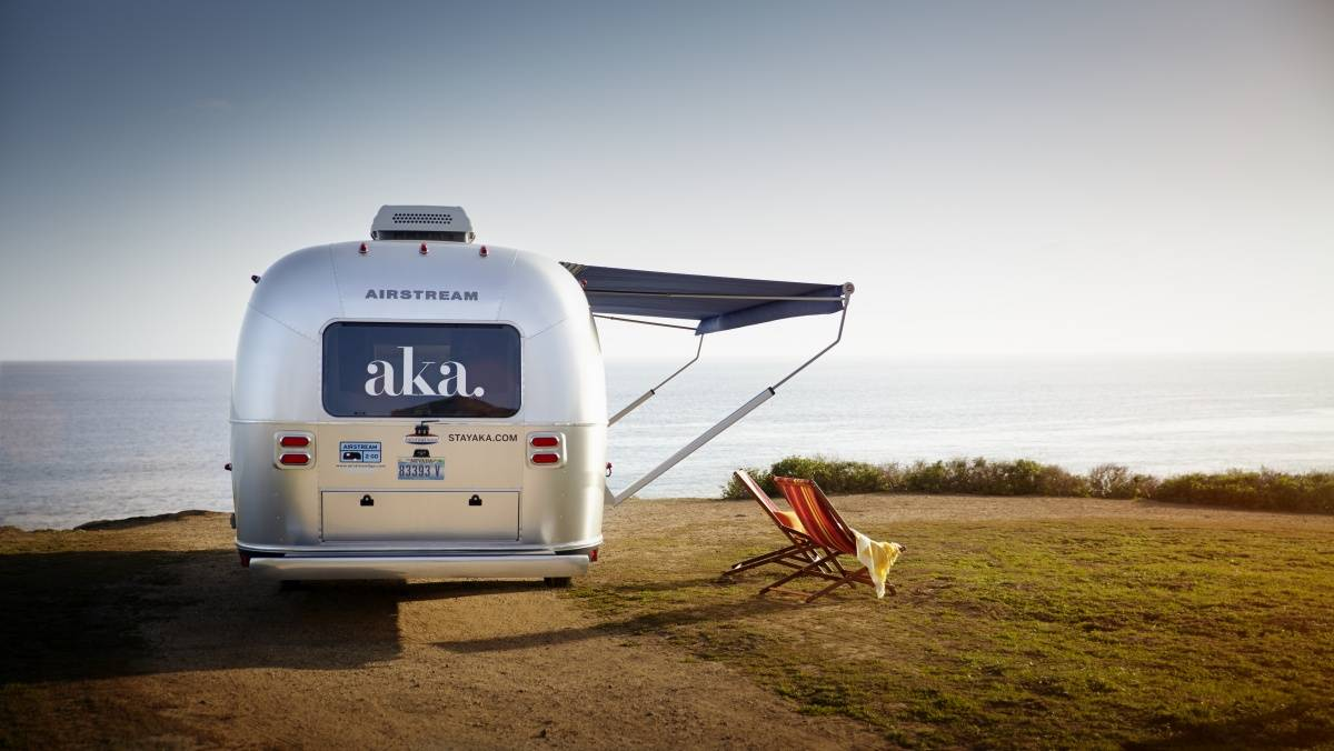 AKA Mobile Suite Exterior With Lounge Chairs