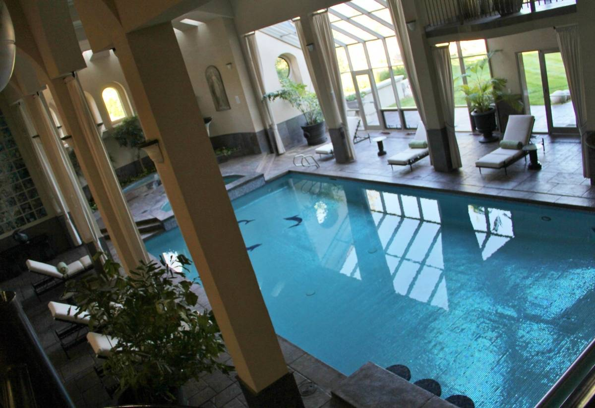 The magnitude of this jaw dropping mansion is unfathomable for Average square footage of a swimming pool