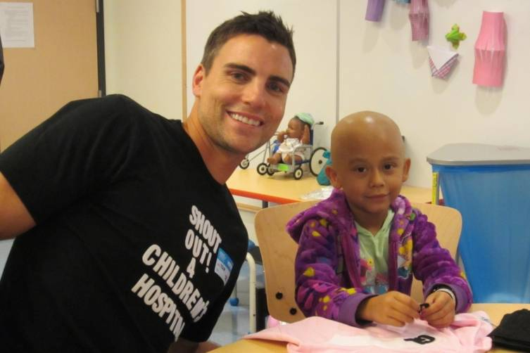 Colin at the Children's Hospital with a brave child