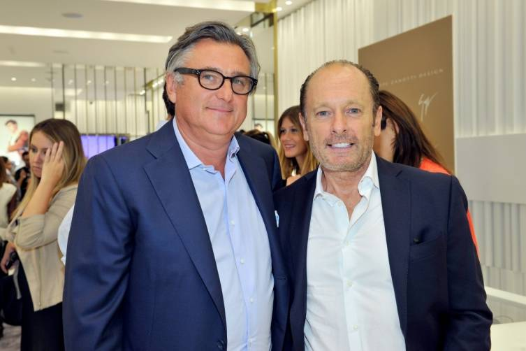 President of Giuseppe Zanotti Alain Baume (L) and producer Stefano Gallini-Durante