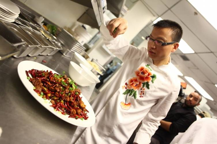 Chef Tony Hu applies finishing touch to famed Three Chili Chicken dish
