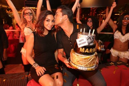 Mario Lopez gives his wife a kiss on the cheek at XS Nightclub. Photos: Karl Larson and Danny Mahoney