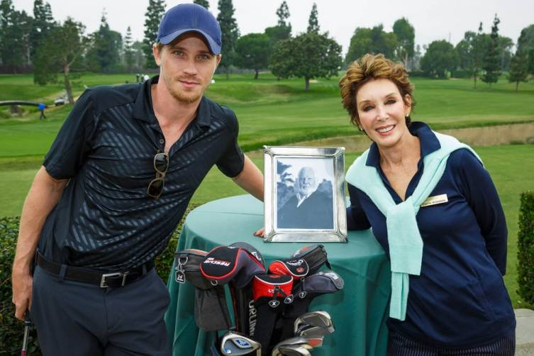 Garrett Hedlund and Carrie Brillstein get ready for the Bernie Brillstein Golf Tournament