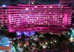 the Fontainebleau lit up in pink