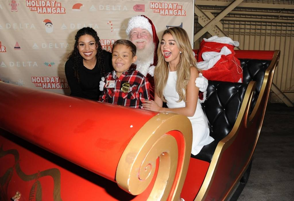 Jordin Sparks and Sarah Hyland at Delta Air Line's Fourth Annual Holiday in the Hangar