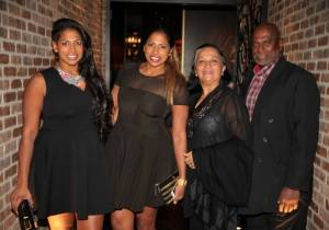Nadiya and Natalie Anderson pose for a photo with their parents at Andiamo inside the D Las Vegas