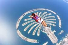 Omar Alhegelan floats above Palm Island during one of his world famous skydive performances.