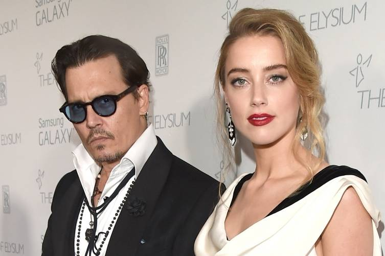 Amber Heard and  Johnny Depp attend the Art of Elysium Gala