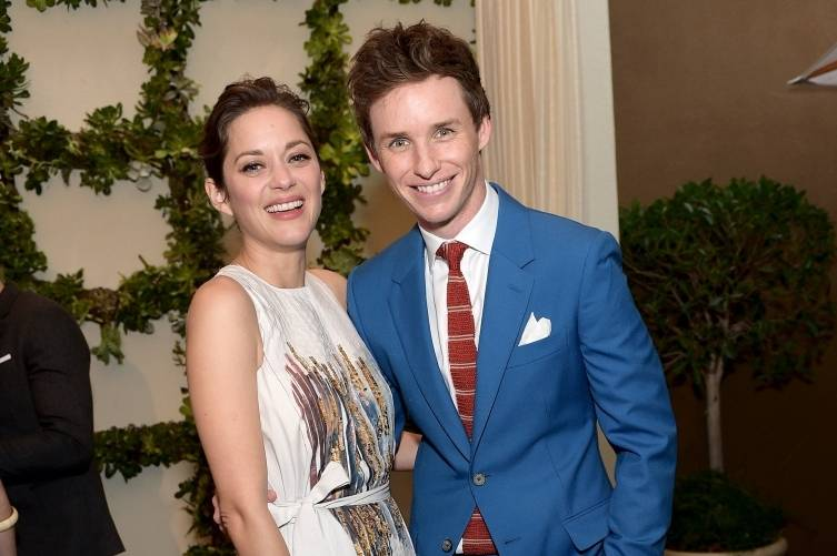 Marion Cotillard and Eddie Redmayne attend the 2015 BAFTA Tea Party