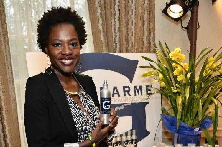Viola Davis posing with Gendarme colognes at the HBO Luxury Lounge