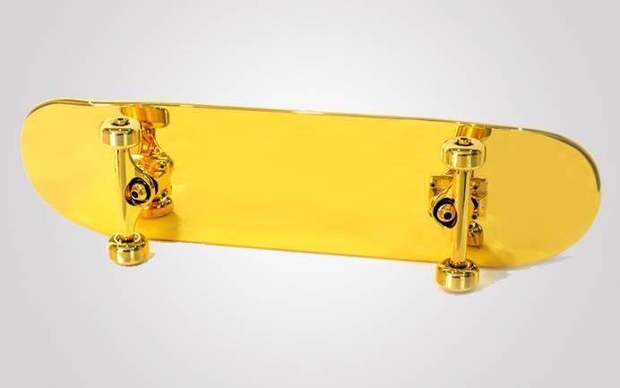 Shut gold-plated skateboard
